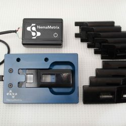 The ScreenChip Starter Kit: A ScreenChip Dock, signal amplifier and ten ScreenChip cartridges.